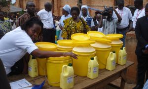 USAID workers distribute nutritional supplement