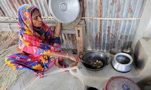 Woman preparing food in Satkhira, Bangladesh