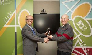 Alejandro Nin-Pratt (left) receives the Elsevier Atlas Award