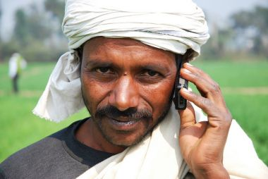 Farmer with his mobile phone in Bihar, India.