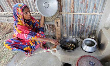 Woman preparing food in Satkhira, Bangladesh
