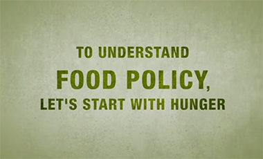 "Video slide saying ""To understand Food Policy, let's start with Hunger"""