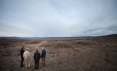 Four researchers surveying degraded land in Argentina